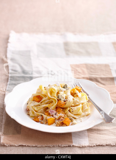 Plate of chicken and vegetable pasta - Stock Image