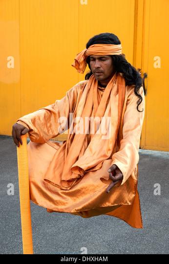 Hindu Fakir street performer doing levitation trick, Rome, Italy - Stock Image