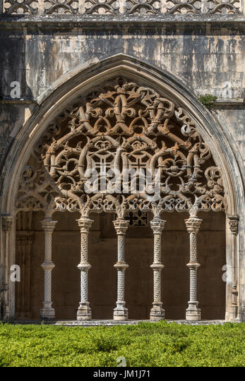 Arch in the Cloisters at the Monastery of Batalha - a Dominican convent in the town of Batalha, in the Centro Region - Stock Image