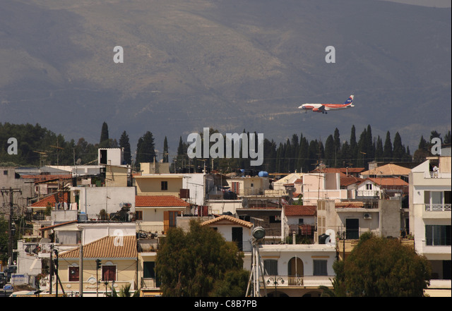 Greece. Zante (Zakynthos). Partial view and an aeroplane overflying the city. Island of Zante. Ionian Islands. - Stock Image