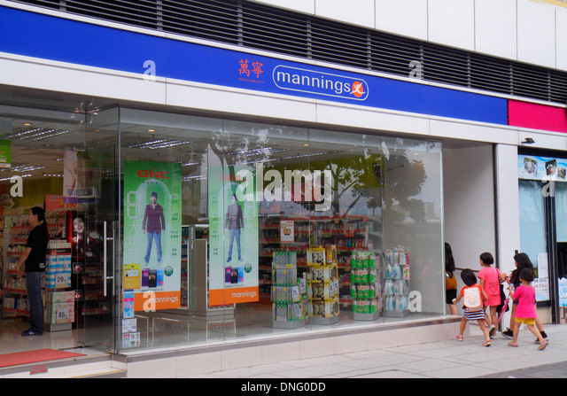 China Hong Kong Kowloon To Kwa Wan Mannings pharmacy drugstore front entrance Cantonese Chinese characters hànzì - Stock Image
