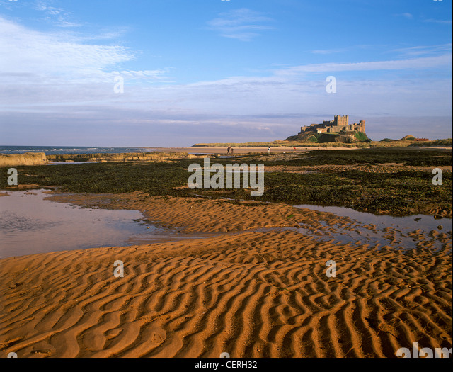 Bamburgh Castle from the foreshore. - Stock Image