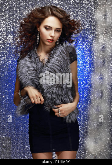 Femininity and Sensuality. Gorgeous Sophisticated Lady in Fur Vest - Stock Image