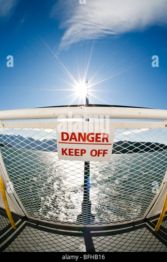 A sign on a ferry railing states 'Danger - Keep Off'. - Stock-Bilder