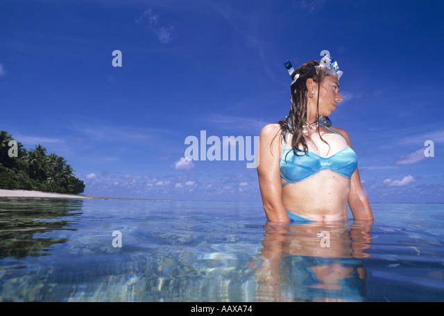Snorkeller on coral reef in the Marshall Islands - Stock Image