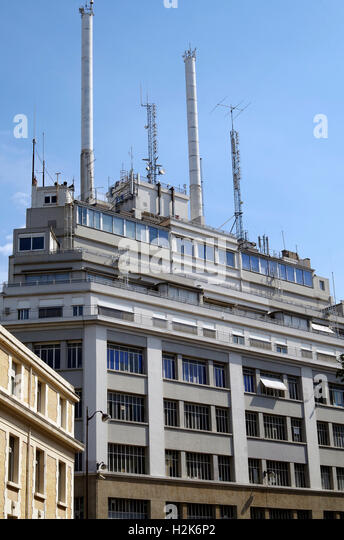 Unidentified building in Paris with large array of aerials, satellite dishes and other paraphernalia on it's roof, - Stock Image