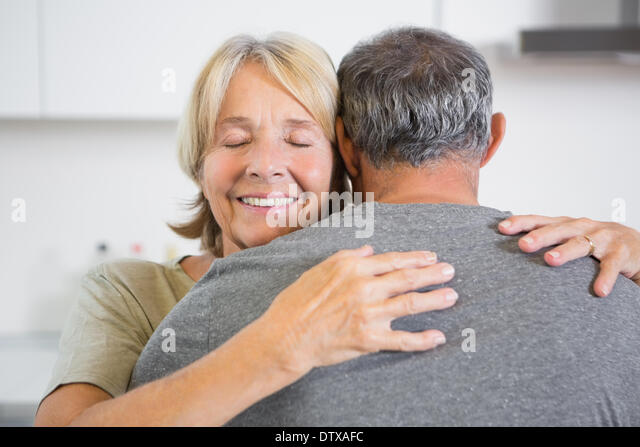 Joyful couple embracing - Stock Image