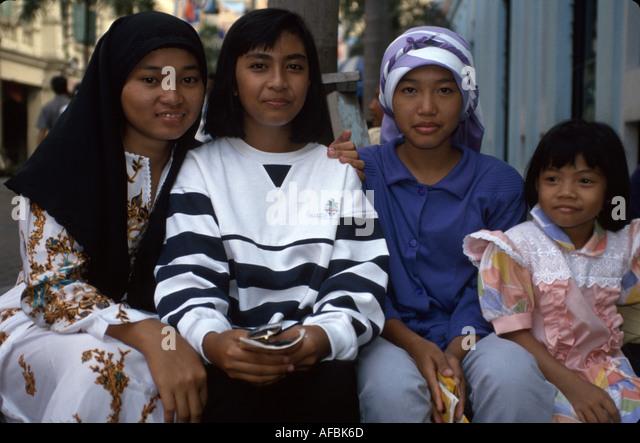 Malaysia Kuala Lumpur Muslim women child fashionable clothing head cover - Stock Image
