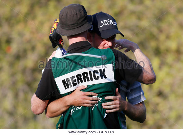 John Merrick (back) of the U.S. hugs his caddie Ryan Goble as he celebrates winning the Northern Trust Open golf - Stock Image