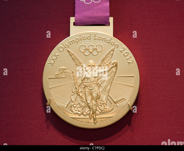 The 2012 Olympic Games Gold Medal on display in the British Museum in London - Stock Image