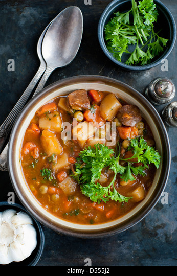Bowl of stew with herbs - Stock Image