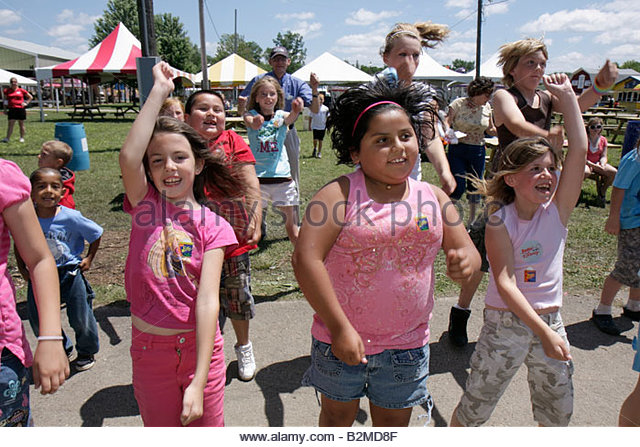 Wisconsin Kenosha Kenosha County Fairgrounds The Ultimate Kid Fest family event Hispanic girl boy childhood fun - Stock Image