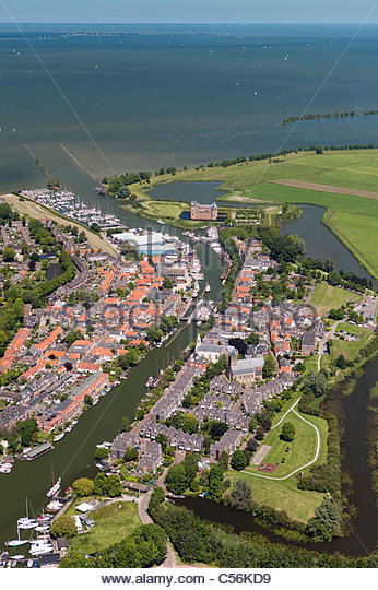 The Netherlands, Muiden, aerial view on village, castle called Muiderslot and lake called IJsselmeer. - Stock Image