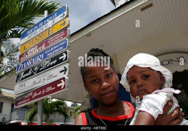 Saint Martin Marigot French Rue Charles De Gaulle Black female teen baby - Stock Image