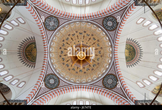 Decorated ceiling of Suleymaniye Mosque showing intersection of four domes with the main big dome, Istanbul, Turkey - Stock Image