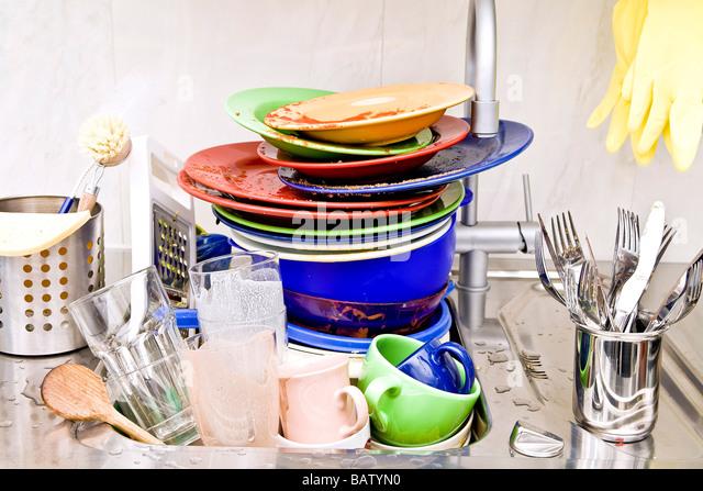 washing-up in kitchen sink - Stock-Bilder