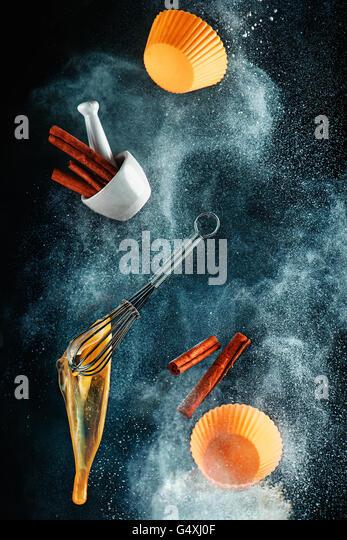 Kitchen mess: baking cinnamon cakes - Stock Image