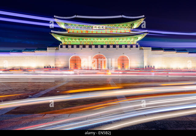 Gwanghwamun gate at Gyeongbokgung Palace in Seoul, South Korea with light trails from moving traffic. - Stock Image