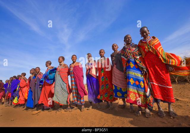 Masai villagers, Masai Mara National Park, Kenya - Stock Image
