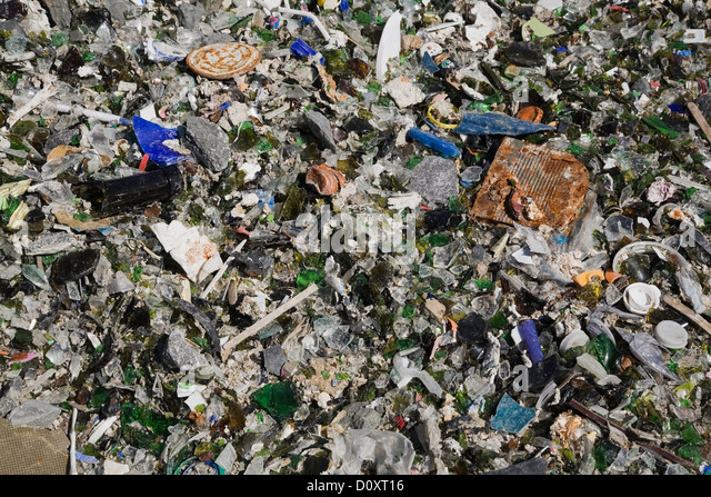 Broken glass and other debris at waste management site - Stock Image