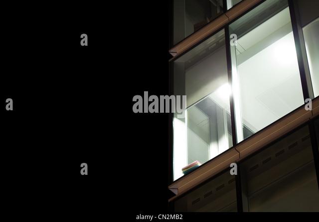 Light in window of office building, London, UK - Stock-Bilder