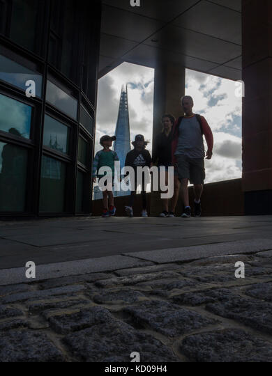 An unusual view of the Shard from the North Embankment with people walking, holding hands - Stock Image