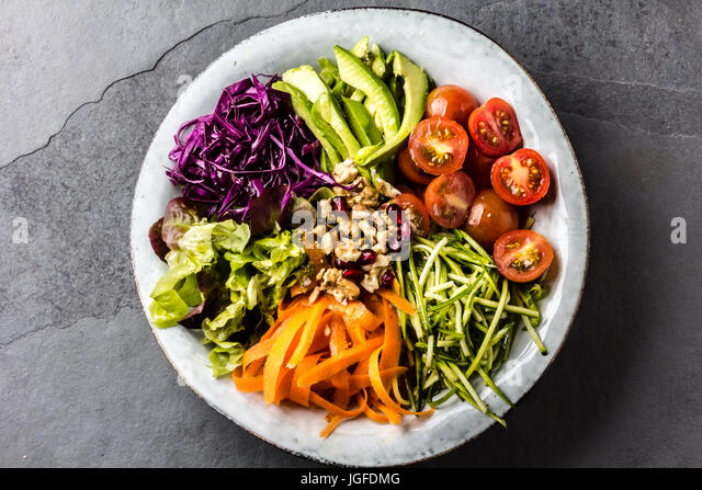 Buddha bowl. Vegetables nuts salad - Stock Image