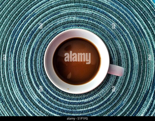 A coffee cup viewed from the top. - Stock Image