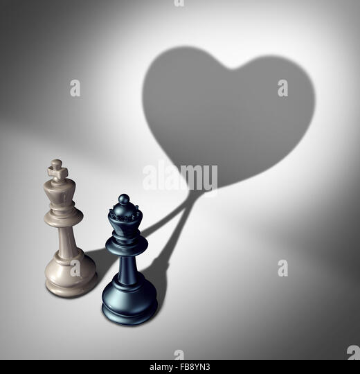 Couple in love as a valentine's day concept as a white king and black queen chess piece casting a united cast - Stock-Bilder