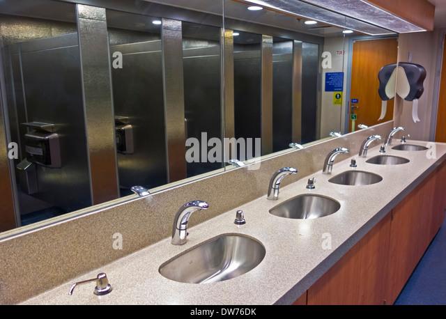 Public bathroom mirror stock photos public bathroom for Public bathroom sink