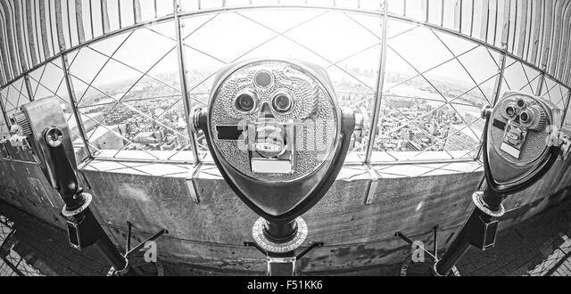 Black and white fisheye lens toned photo of tourist binoculars over Manhattan, New York City, USA. - Stock Image