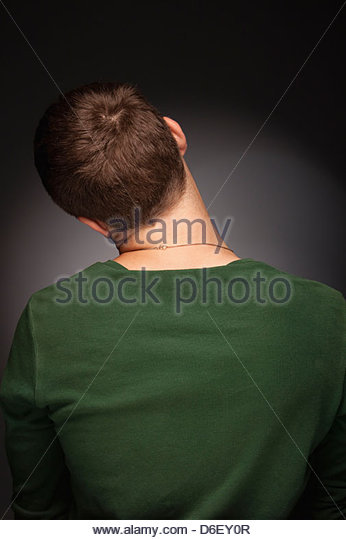 Teenager boy man rear view back shy - Stock Image