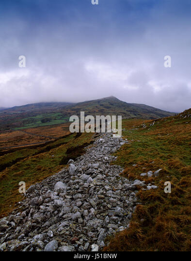 Pen y Gaer Iron Age hillfort, Conwy, Wales: view WNW along the three southern ramparts (stone, earthen banks and - Stock Image