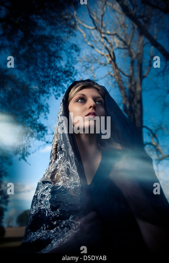 Woman wearing scarf over head fashion portrait - Stock Image