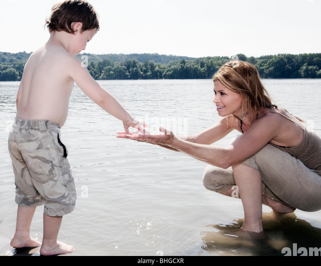 Mother encouraging Child - Stock Image