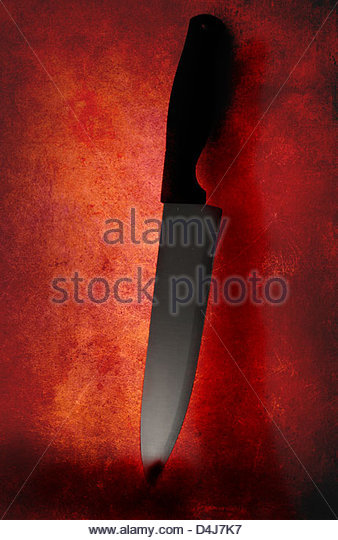 Knife used as a weapon has got blood on it - Stock Image