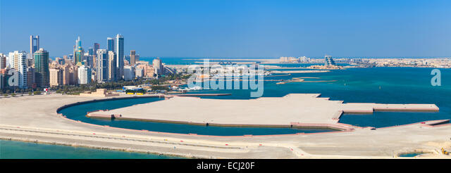 Bird view panorama of Manama city, Bahrain. Skyline with modern skyscrapers standing on the coast of Persian Gulf - Stock Image