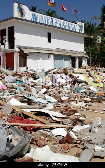 Sri Lanka, fashion shop on SW coast near Beruwela damaged by 2004 tsunami, mannequin amongst rubble of destroyed - Stock Image