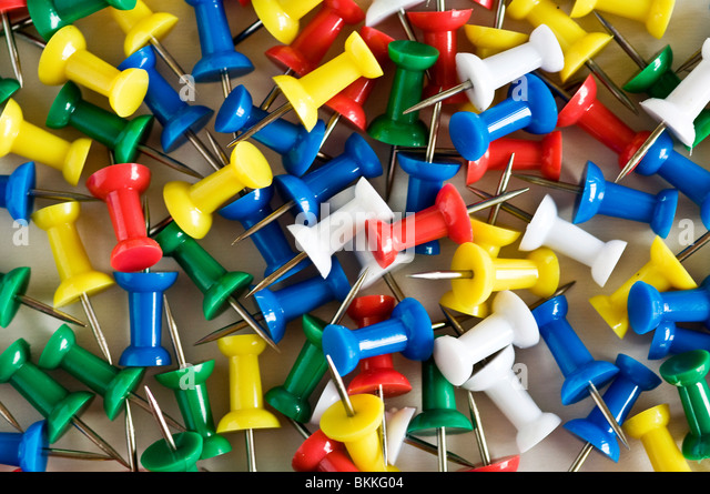 Collection of multi-coloured push pins. - Stock Image