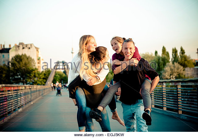 group of young adults have fun together - Stock Image