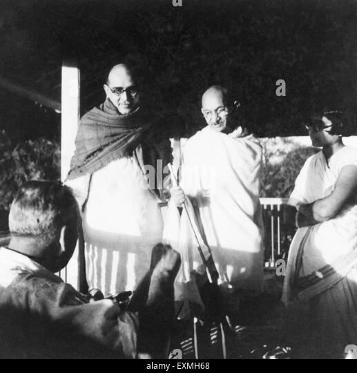 Dr. Hermann Kallenbach ; Mahadev Desai ; Mahatma Gandhi and an ashramite at Bardoli ; 1939 ; India NO MR - Stock Image