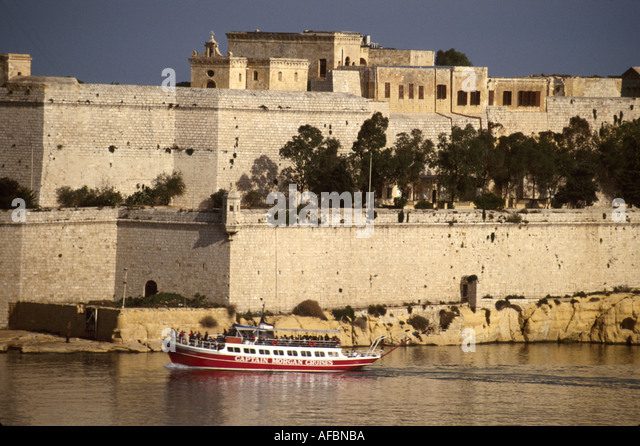 Malta Valetta Grand Harbour 16th Century fortified planned city once home to Knights of St. John tour boat - Stock Image