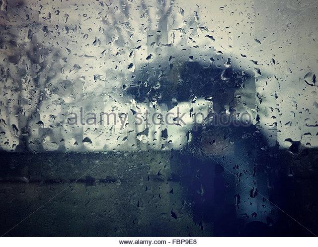 Man Seen Through Wet Glass Window During Monsoon - Stock-Bilder