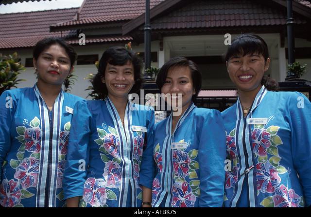 Malaysia Kuala Lumpur National Museum female attendants guides batik dresses - Stock Image
