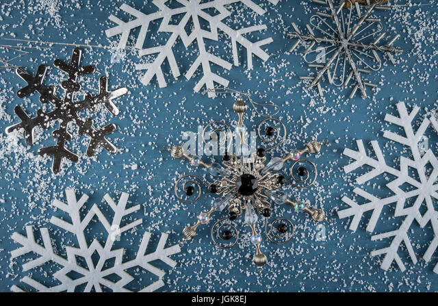 Variety of Snowflake Ornaments and Snow Winter Background Image - Stock Image