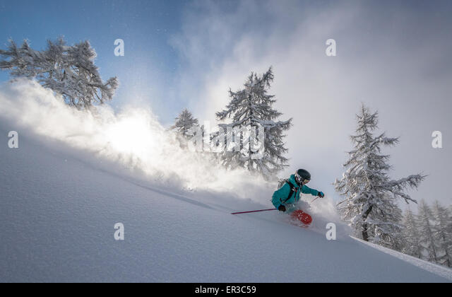 Man deep powder skiing in Austria - Stock Image