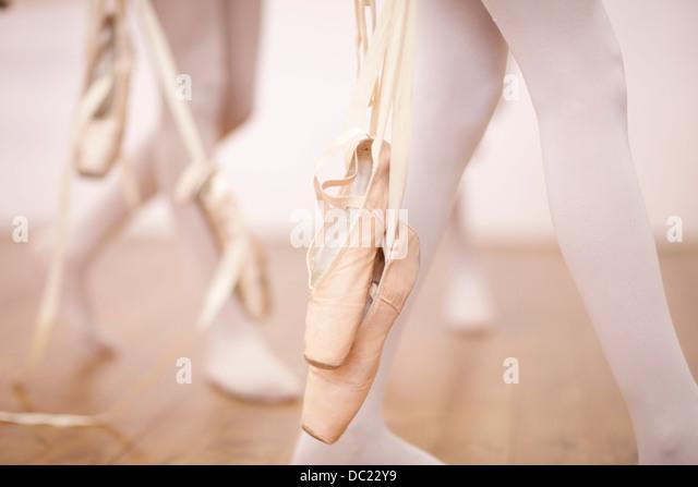 Detail of ballerinas legs leaving dance studio - Stock-Bilder