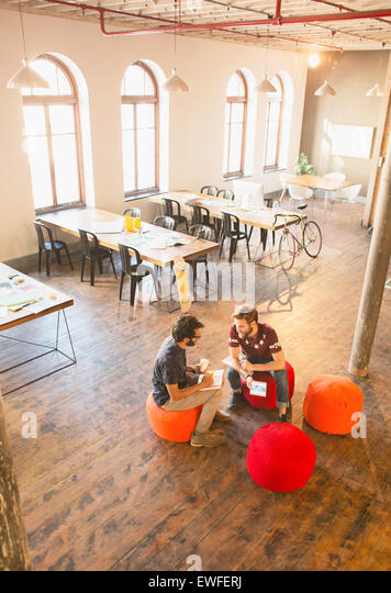 Casual businessmen meeting in open office - Stock Image
