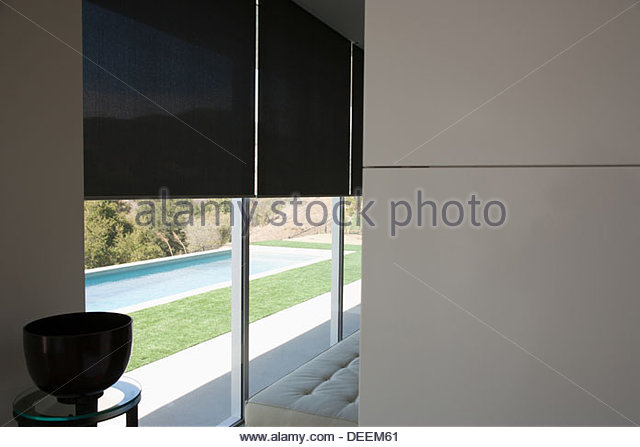 Interior of modern home with swimming pool - Stock Image