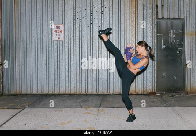 A young brunette woman exercising and boxing - Stock-Bilder